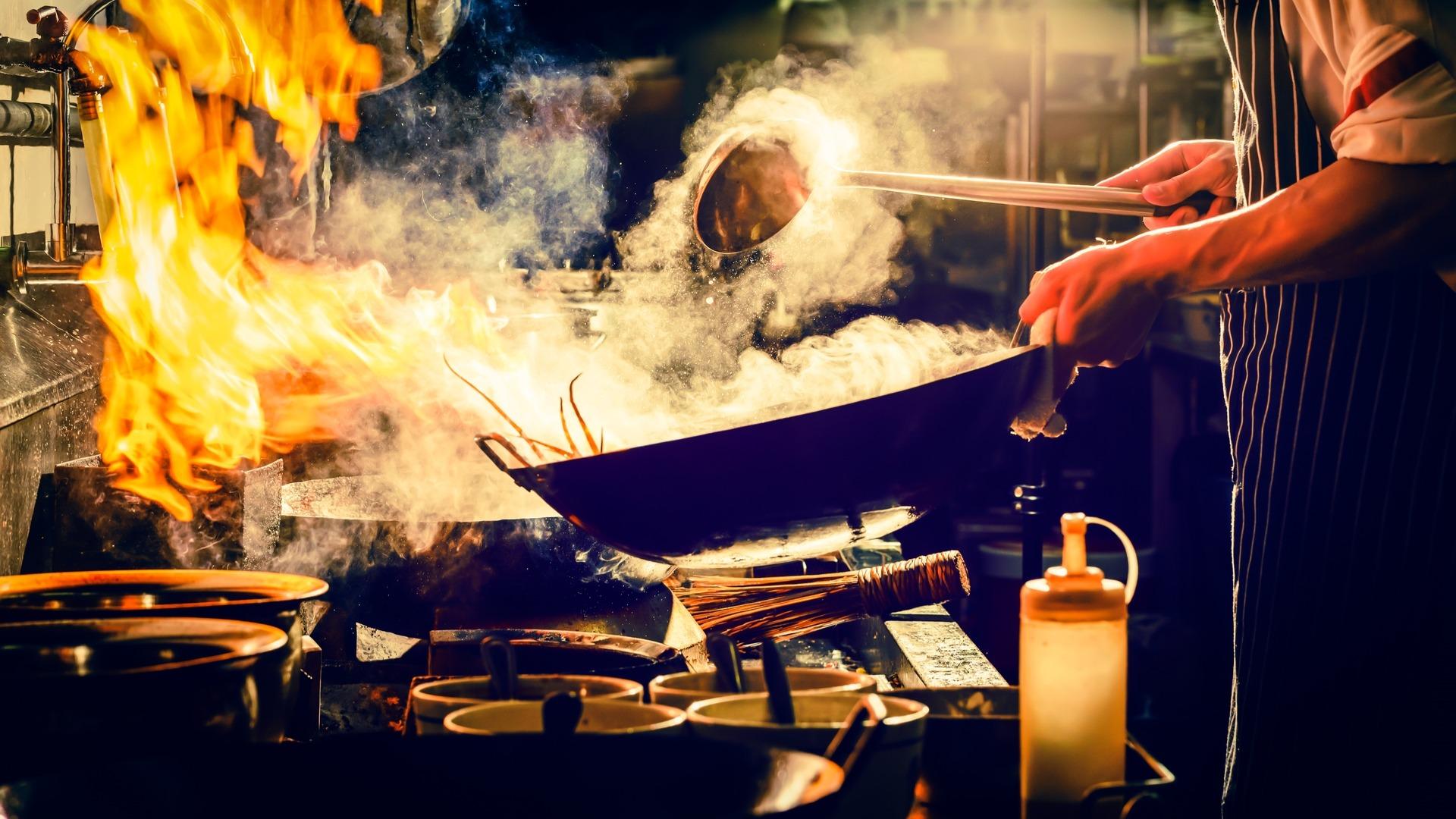 Cook using a wok