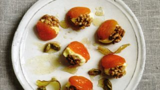 Persiana Syrup poached apricots with walnuts and clotted cream